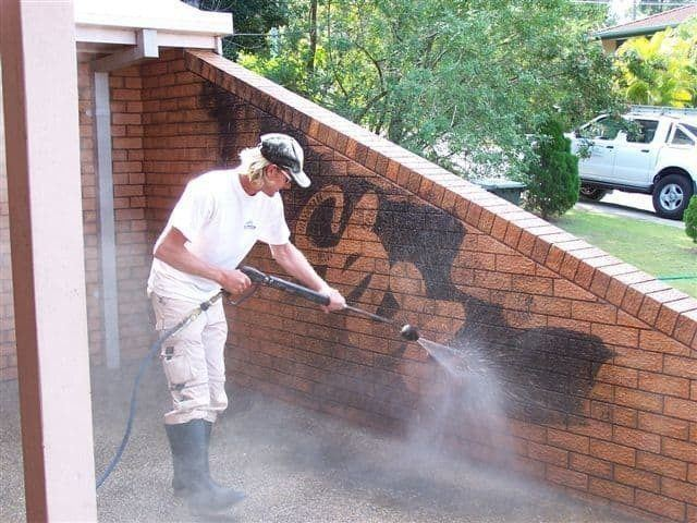 Graffiti Removal  Picture of Professional During Process
