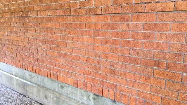 Show the brick wall after graffiti removal service